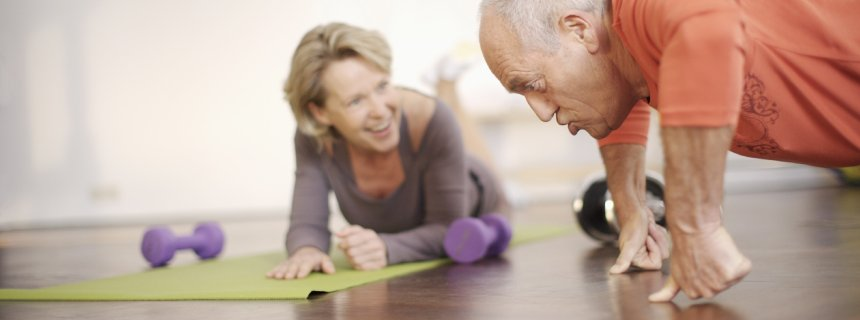 Couple exercising in health club